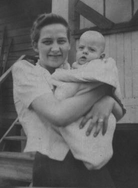 My mother holding me as an infant.
